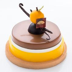"""Instagram media by alexisbouillet - Coming soon in our Cake Shop. """"Camille""""  Yuzu -  Ponkan (mandarine) - milk chocolate With @frankhaasnoot  Thanks Chef to gave me this opportunity to developing this cake.  #camille #yuzu #ponkan #milkchocolate #localflavour #cakeshop #cake #passion #pastrylove #chef #frankhaasnoot #taiwan #taipei #hotel"""