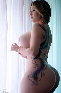 Wide hips and Naked. The tattoos too oh my :)