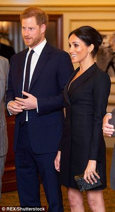 Meghan stuns in a tuxedo dress alongside Harry at Hamilton musical 4b0c8339e8b5