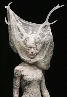 Alexander McQueen, is a genius. This lace dress, antlers draped in lace, how incredible!
