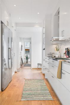 All white kitchen with a rug