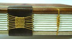 """Detalhe da costura    Livro da nova série """"Weave""""    Série limitada de livros numerados com capas de retalho de papel japonês com transferência de polaróide."""