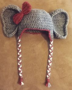Crochet Alabama Elephant Hat Ear flap hat pattern : http://allicrafts.blogspot.com/2011/01/free-pattern-baby-earflap-hat-3-months.html?m=1 Bow pattern modified from here: http://www.craftinessisnotoptional.com/2013/01/easy-crochet-bow-tutorialpattern.html Couldn't find a pattern I liked for ears, but this is what I did: Crocheted by K Olds. Using 2 strands of worsted weight yarn and I/9 hook, Chain 7. R1: Dc 3rd Ch from hook and each st across (5) (ch 3 counts a...