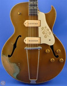The Gibson ES-295 was introduced in 1952 at a purchase price of just under $300. Made famous by Scotty Moore, who played for Elvis Presley, (and more importantly, Geordie Walker from Killing Joke) the 295 is a versatile stage guitar with a gleaming, gold lacquer finish and a floral pickguard design. The ES-295 actually shares a trajectory of innovation similar to the Les Paul. Both models, for example, switched from P-90 to humbucker pickups in 1957.