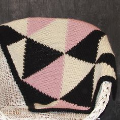 Knitted Triangle Throw or Baby Blanket in Black/Cream/Dusty Pink. YarningMade Etsy.