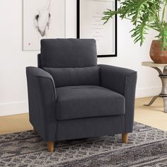 Perfect for curling up with a good book or spreading out while you watch a movie, an armchair like this is a great option for creating a cozy nook or additional seating in any living space. Living Spaces, Living Room, Cozy Nook, Curling, Small Spaces, Accent Chairs, Armchair, Upholstery, Sink