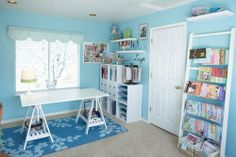 Really pretty clean looking space. Love the blue and white and the ladder to hold magazines