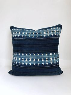 These pillow covers are made to order so design may vary slightly. Due to the vintage nature of this fabric flaws from wear and age may be present and are not considered to be defects. FRONT: These one of a kind pillows are handcrafted from vintage indigo African textile BACK: Hopsack linen with bottom zipper COLORS: Indigo and white design SIZE: 20x20 inches  FABRIC: Vintage indigo textile on front and linen on back. Due to the nature of vintage textiles, there may be spots, patches, marks…
