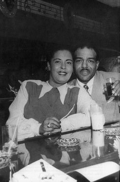 Billie Holiday and rhythm guitarist Freddie Green (?) from Count Basie's band
