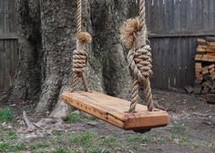 Charming tree swing made of reclaimed pine