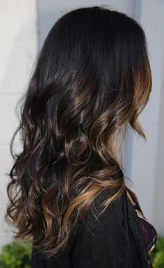 Peek a boo color. Dark brown with caramel highlites, long curly hair
