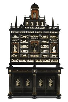 A BAROQUE STYLE EBONY, EBONISED, ROSEWOOD AND IVORY INLAID CABINET ON STAND SOUTH GERMAN, 19TH CENTURY, WITH EARLIER ELEMENTS