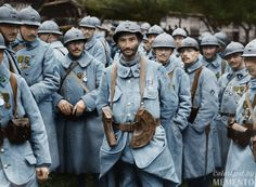 French soldiers who have been awarded medals during the Battle of the Somme. Several wear the Croix de Guerre with Stars and Palms. The man in front is a squad machine-gunner,evident by his crescent shaped magazine pouches. Two to his left, with a yellow stripe on his arm, is a sub-lieutenant, and the man to his right with dark collar tabs a combat engineer. Many have chevrons on their left sleeve denoting length of service: one chevron for 6 months, two for a year, three for two years.