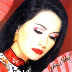 """Ana Gabriel (Mexico) - (born María Guadalupe Araújo Yong, December 10, 1955) is a Mexican singer and composer from Santiago de Comanito, Sinaloa, Mexico. She first sang on the stage at age six, singing """"Regalo A Dios"""" by José Alfredo Jiménez. She moved to Tijuana, Baja California and studied accounting. At age 21, in 1977, she recorded her first song, titled """"Compréndeme"""". During her long career, she has hits in three different genres of music: rock en español, Latin Pop, and rancheras."""