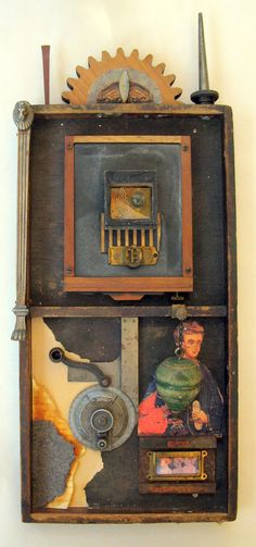 An abstract mixed media assemblage for hanging. The found objects in this work are placed within a vintage shallow box. The piece is ready to