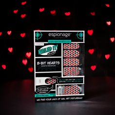 8-bit Hearts nail wraps from Espionage Cosmetics. These bad boys glow-in-the-dark and have a clear base, so you can paint whatever color you want beneath the wee hearts. Photo by Sheetar.com. #EspionageCosmetics #NerdManicure #Nails #NailWraps #NerdNails #NailArt #8bit #8bithearts #Nailspiration #Retro #RetroGaming