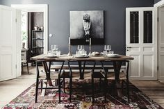 Dining room with grey walls, rustic table and designer chairs anchored by a patchwork rug . Dining Room Design, Dining Room Table, Dining Area, Vintage Apartment, Interior And Exterior, Interior Design, Rustic Table, Rustic Wood, Scandinavian Home