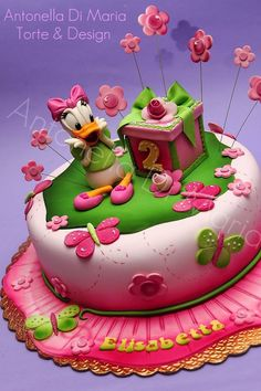 2 year old birthday cake - Disney Daisy Duck, butterflies, flowers in pink and green
