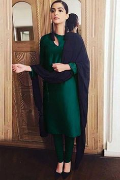 Dress green Sonam Kapoor Taffeta Silk Churidar Suit This Bottle Green Taffeta Silk Churidar Suit which will surely grabs everyone attention.Teamed up with Santoon Churidar in Dark Green Color with Black Chiffon Dupatta. Plain Kurti Designs, Silk Kurti Designs, Churidar Designs, Kurta Designs Women, Kurti Designs Party Wear, Blouse Designs, Salwar Neck Designs, Designer Kurtis, Indian Designer Suits