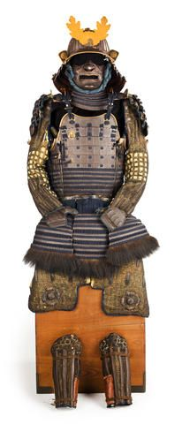 "A suit of armor with a go-mai okegawa do Edo period (18th century) Laced in blue with the components lacquered russet brown and comprising a thirty-plate suji kabuto mounted with a four-stage gilt-metal and shakudo tehen kanamono, the mabizashi and gold lacquer fukigaeshi trimmed with gilt-copper ""rope"" fukirin, the bowl fitted with a five-lame Hineno shikoro terminating in fukigaeshi applied with gilt-copper heraldic crests, the gilt-copper maedate formed as a chrysanthemum flower and…"