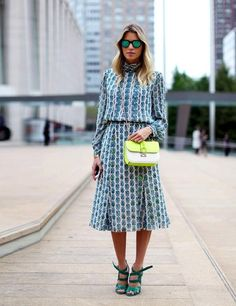 Long sleeve print dress paired with a neon cross body bag