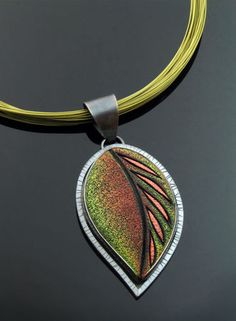 Leaf Pendant in polymer clay and oxidized silver on green multi-strand stainless steel cable necklace by jeweler Grace Stokes. (Photo courtesy of Grace Stokes)
