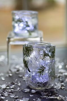 Winter Wonderland Decor: DIY Faux Ice Candle Holders - Entertaining Diva @ From House To Home - These DIY faux ice candle holders made from mason jars are an easy way to add some sparkle (without - Blue Candle Holders, Mason Jar Candle Holders, Mason Jar Candles, Scented Candles, Ostrich Feather Centerpieces, Floral Centerpieces, Table Centerpieces, Wedding Centerpieces, Pot Mason Diy