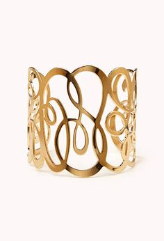 This filigree cuff from forever 21 is just right for $4.80!