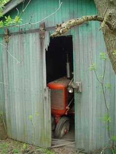 Old tractor trying to get out of the barn...