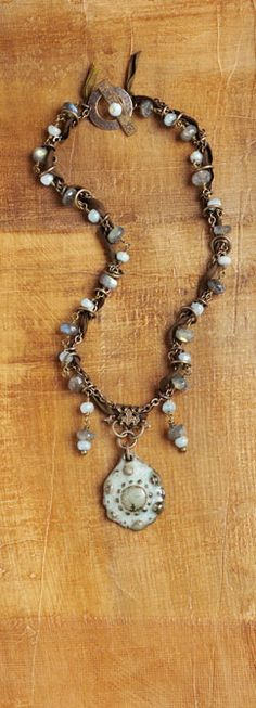 Design by Denise Yezbak Moore featured in the book, Bohemian-Inspired Jewelry. Ceramic pendant by Gaea.