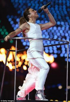 Mel C went hip with white jumpsuit, metallic trainers (!!) and slick ponytail. Her tats? Totally completed the look. #socialbliss