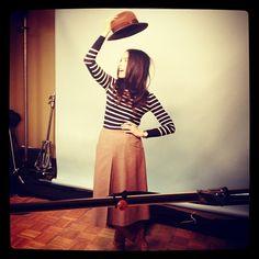 black stripes + brown midi + boots