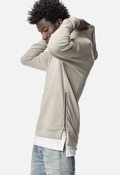 Slim fit hoodie with vertical Riri side zippers that conceal a hidden kangaroo pocket. Custom USA knit terry with flatlock stitch details. 100% cotton.