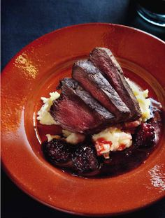 Juicy blackberries add interest and depth to the lean ostrich meat in this recipe, while the celeriac mashed potatoes provide the perfect comfort food. Dutch Recipes, Meat Recipes, Cooking Recipes, Game Recipes, Ostrich Meat, Sausage And Mash, Blackberry Sauce, Bangers And Mash, Onion Gravy
