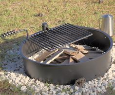 """AmazonSmile : 32"""" Steel Fire Ring with Cooking Grate Campfire Pit Park Grill BBQ Camping Trail : Patio, Lawn & Garden"""
