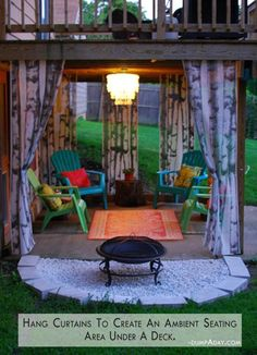 Hang curtains under the deck to add color and coziness.