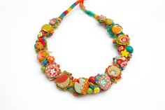 Flower statement necklace, crochet with fabric buttons and wooden beads, orange chartreuse, OOAK