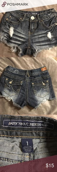 Almost Famous cutoff denim shorts Dark wash cutoff denim shorts by Almost Famous size 1 bling on right front pocket great used condition  GUC Almost Famous Shorts Jean Shorts