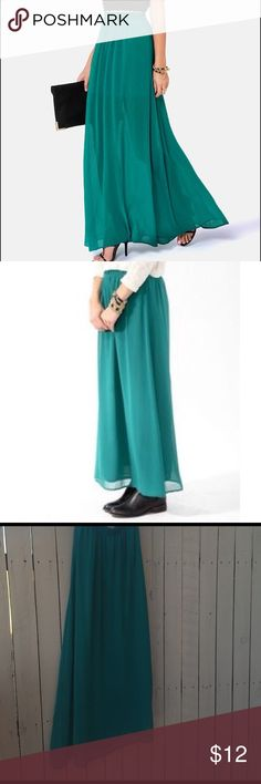 St. Patrick's Day Teal Chiffon Maxi Skirt Only worn once to work- this skirt is a breezy chiffon like material in a gorgeous teal shade. Waist band is elastic. I paired mine with a white crop and black leather Moto jacket. I love how versatile this skirt is. I own it in 5 colors so time to part with this one. There are a few dark spots that are only noticeable if you are looking for them. Pointed them out in photos. The 2nd modeled photo is the exact skirt, photo is forever 21 stock photo…