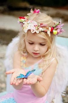 adorable little girl with blue butterfly