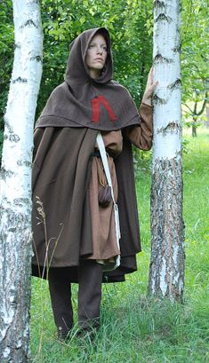 Bocksten     full reconstruction of garment found in Bocksten (Sweden). Surviving pieces are woolen hose, tunic, cloak and hood. On the left side is shown hood, the best preserved part of excavation. It was well tailored. The red V shaped cloth still remain questionable. Dress is entirely hand sewn. (half of 14th century)