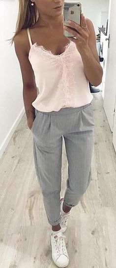 #spring #outfits woman in pink spaghetti-strap blouse and grey pants. Pic by @fashionative #dressescasualspring