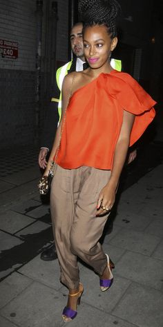 Lanvin bright orange one-shoulder top, taupe trousers from Zara, and Fendi's Grosgrain Mix Sandals