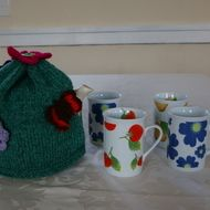 Keep your favourite pot of Tea nice and hot with this thick warm Aran weight yarn in a two tone, green fleck Teapot Cosy.  The cosy has been decorated with crochet and knitted flowers and a stylized Red Admiral crochet Butterfly.  It will fit a six cup...