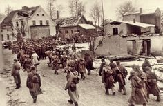Soviet troops advance through a German town on the outskirts of Koenigsberg, Jan 1945.