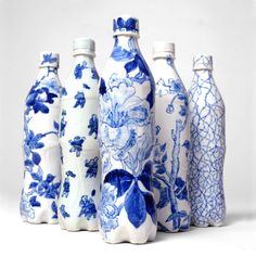 Taikkun Li, a Chinese artist now living in the United States, created a collection of Coca-Cola bottles.