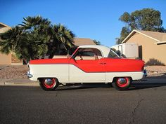 1958 red and white Nash Metropolitan. Just like my first car only mine was painted Lilac