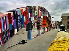 It took a year and a half and zip ties to yarn bomb this bridge in Ontario -- seen on: 10 Ambitious Yarn Bombing Projects Freeform Crochet, Crochet Yarn, Bernard Shaw, Yarn Bombing, Shabby, How To Purl Knit, Types Of Yarn, Environmental Art, Love Crochet