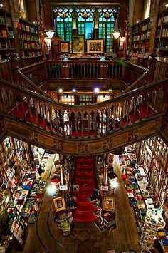 Another view of perhaps the most beautiful bookstore in the world. Lello & Irmao in Porto, Portugal usually makes the various lists of The Top 10 Most Beautiful Bookstores in the World. It opened in 1906 and features stunning Art Deco woodwork, a stained glass ceiling, and ornate shelving with a dramatic staircase up the center of the store.