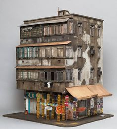 3/4 view (daytime version) of my completed Hong Kong miniature based on 23 Temple Street in Kowloon for the VOLTA Art fair in NYC showing with Muriel Guipen gallery of Manhattan @murielguepingallery. Featuring the work of Yumoh and Xeme @_n.hkg @xememex Check it out on display at Muriel Guipen gallery stand at the VOLTA Art fair, Pier 90 in Manhattan running from March 1-5. Photo credit: Andrew Beveridge/ASB creative. All fully scratchbuilt at 1:20 scale by joshua_smith_street_artist